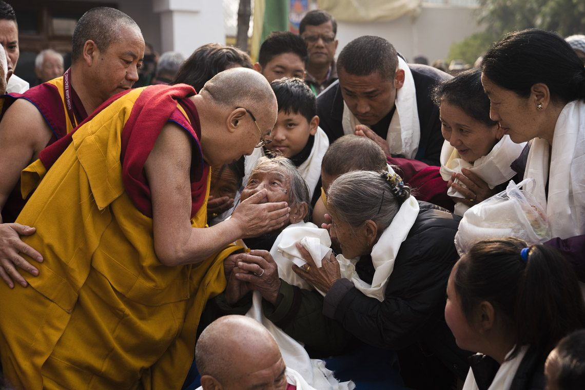 His Holiness the Dalai Lama greeting the elderly lady on his way to the temple in Bodhgaya, India on Jan 17, 2018. (Photo courtesy: T Chojor/OHHDL)