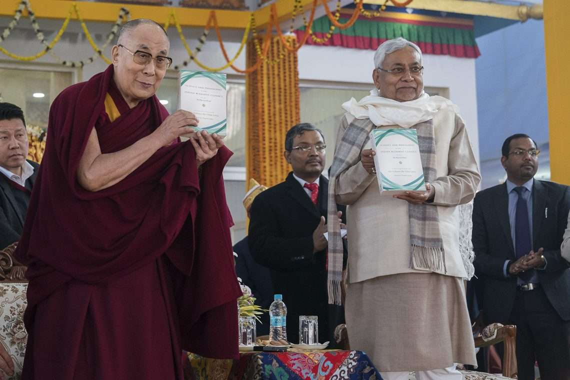 "His Holiness the Dalai Lama and Bihar Chief Minister Nitish Kumar releasing ""Science and Philosophy in the Indian Buddhist Classics, Vol. 1: The Physical World"" in Bodhgaya, Bihar, India on January 7, 2018. (Photo courtesy: OHHDL)"
