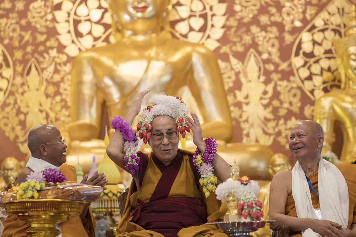 His Holiness the Dalai Lama playfully placing  flower garland over his head at the inauguration of the new Wat Pa Buddhagaya Vanaram Temple in Bodhgaya, Bihar, India on January 25, 2018. (Photo courtesy: T Choejor/OHHDL)