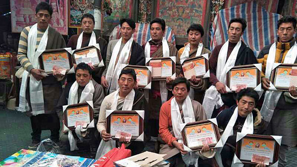Winners of a Tibetan language competition display certificates awarded to them at a conference at Tashi Cheoling Monastery in Chigdril county, Golog Tibetan Autonomous Prefecture, in northwest China's Qinghai province, Jan. 25, 2018. (Photo courtesy: RFA)
