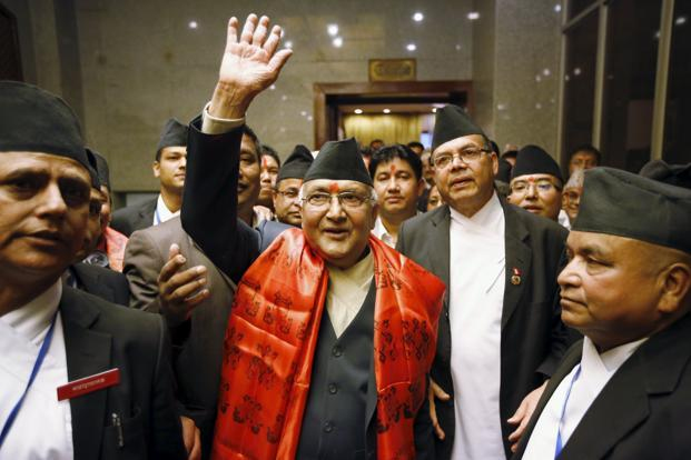 Nepal's newly elected Prime Minister Khadga Prashad Sharma Oli, (centre) waves towards the media after he was elected as Nepal's 38th Prime Minister, in Kathmandu. (Photo courtesy: Reuters)