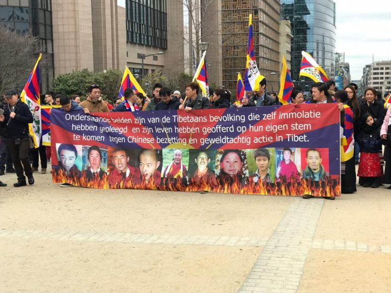 Tibetans in Belgium commemorate the 59th anniversary of Tibetan National Uprising Day event at Schuman Place, Brussels. (Photo courtesy/OOT Brussels)