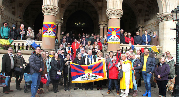 The Mayor Cllr Gareth Eale, event organiser Caroline Scattergood and Representative Chonpel Tsering with Tibet supporters at Northampton's Tibetan flag raising ceremony. (Photo courtesy/Office of Tibet, London)