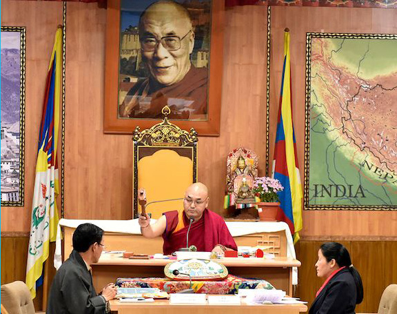 Speaker Khenpo Sonam Tenphel of the Tibetan Parliament-in-Exile concluding the 5th session of the 16th Tibetan Parliament with the traditional striking of the gavel. (Photo courtesy/T Phende/DIIR)