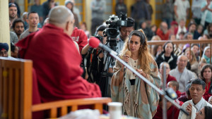A member of the audience asking His Holiness the Dalai Lama a question during his talk to visitors from India and abroad at the Main Tibetan Temple courtyard in Dharamsala, HP, India on April 16, 2018. (Photo courtesy: T Choejor/OHHDL)