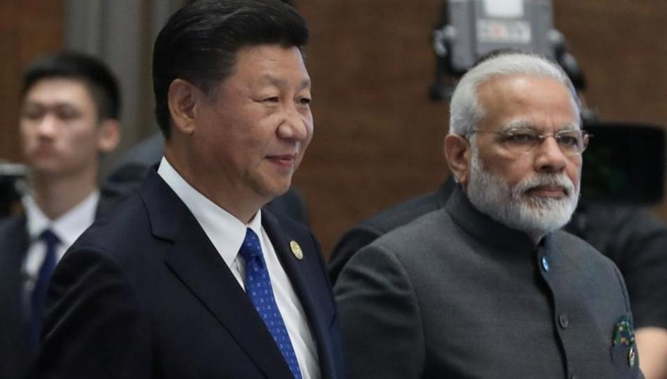 Chinese President Xi Jinping with Indian Prime Minister Mr Narendra Modi. (Photo courtesy: Hindustan Times)
