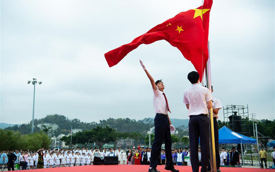 Students of Hou Kong Middle School participate in a flag-raising ceremony marking the Chinese Youth Day in south China's Macao, May 4, 2018. Friday marked the anniversary of the May 4th Movement, a patriotic campaign that started from universities and was launched in 1919 by young Chinese to fight imperialism and feudalism. May 4th later was established as Youth Day in 1949 by the Chinese government. (Photo courtesy: Xinhua/Cheong Kam Ka)