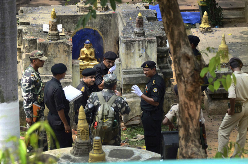 Bodhgaya: NSG and NIA experts collecting samples at Mahabodhi Mahavihara in Bodhgaya on Monday, a day after serial blasts in the temple. (Photo courtesy: PTI)