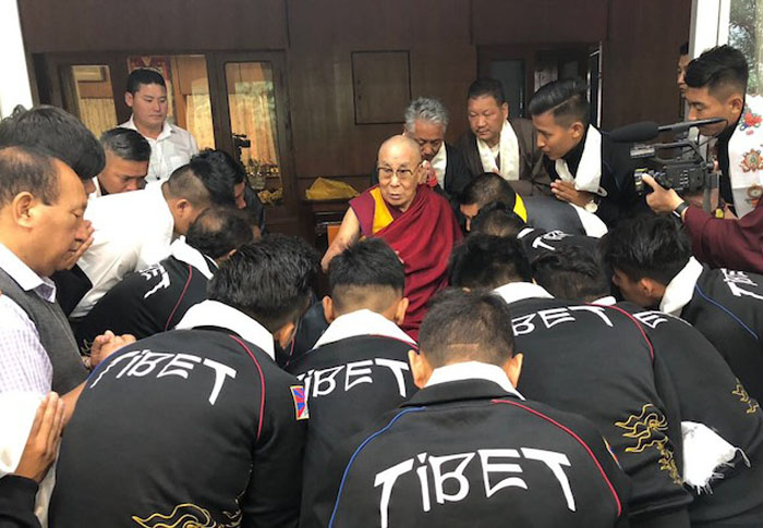 His Holiness the Dalai Lama talking to the members of the Tibetan National Football Team. (Photo courtesy: TIBET.NET)