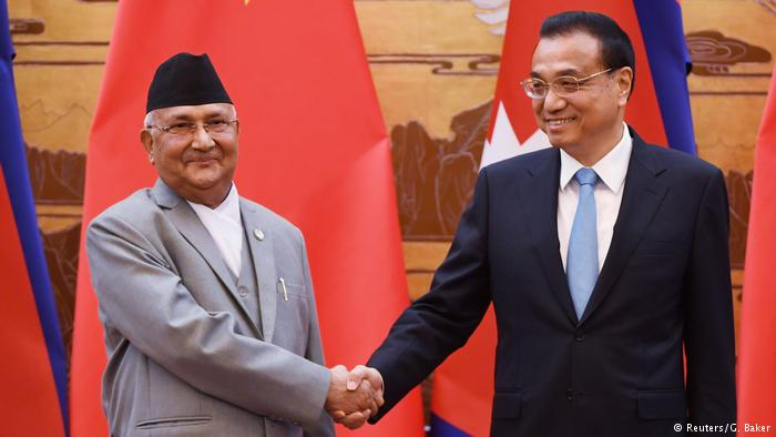 Nepal Prime Minister KP Sharma Oli chats with Chinese Premier Li Keqiang during a signing ceremony at the Great Hall of the People in Beijing, China. (Photo courtesy: REUTERS)