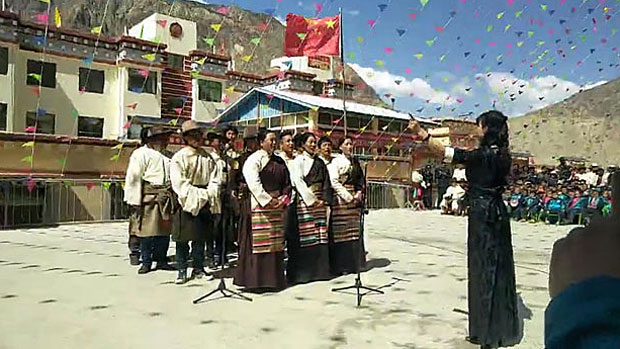 Tibetan villagers in Chamdo sing 'patriotic' songs in a screen grab from a March 29, 2018 video. (Courtesy: RFA)