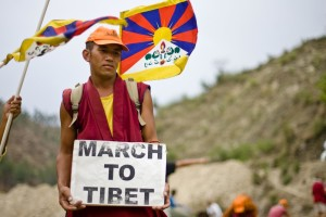 "A Tibetan activist during the 2008 march, Source:""The Sun Behind the Clouds: Tibet's Struggle for Freedom."" documentary by Tenzin Sonam & Ritu Sarin."