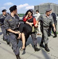 Tibetan carried away after protest against IOC delegates decision for Beijing 2008, Moscow, 2001.