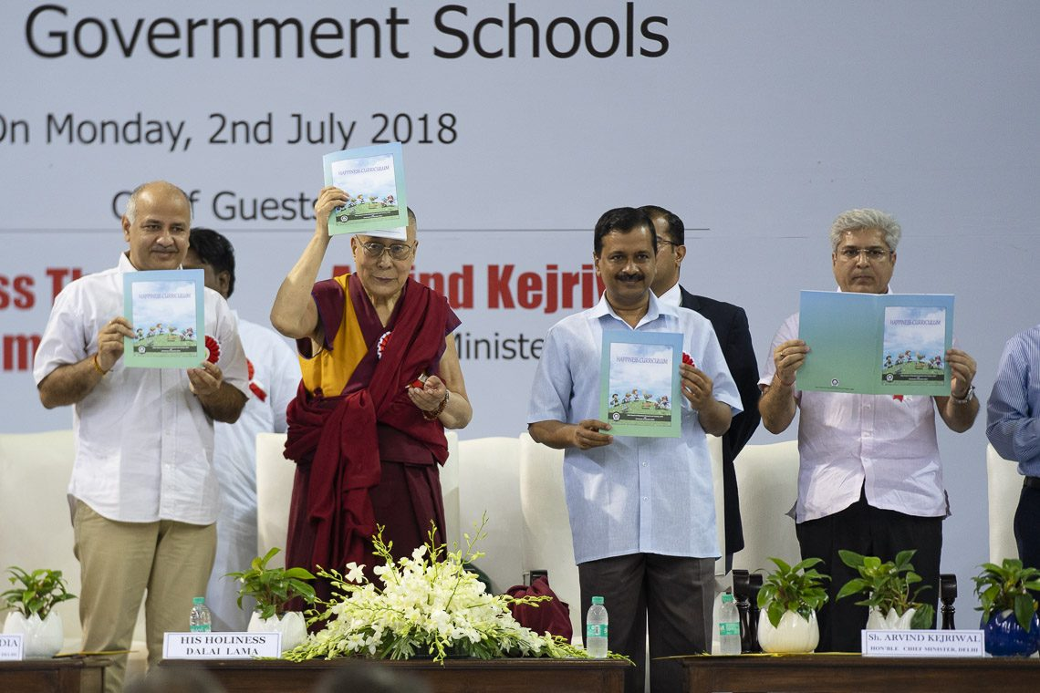 Delhi Deputy Chief Minister Manish Sisodia, His Holiness the Dalai Lama and Delhi Chief Minister Arvind Kejriwal releasing the Happiness Curriculum in Delhi Government Schools in New Delhi, India on July 2, 2018. (Photo courtesy: Tenzin Choejor/OHHDL)