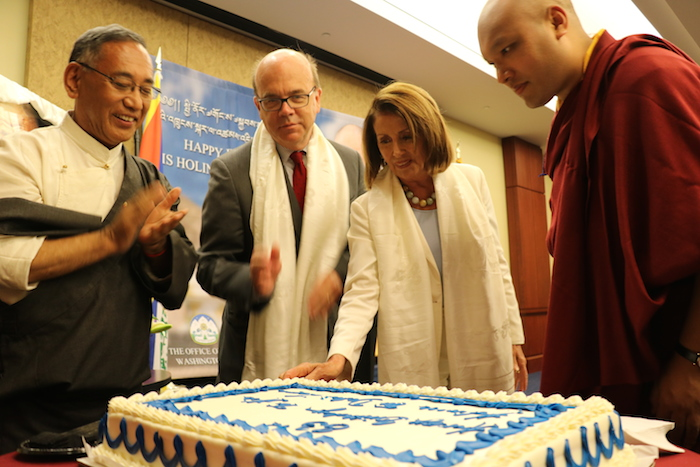 Gyalwa Karmapa, Leader Pelosi, and McGovern cutting the birthday cake during the celebration of His Holiness the Dalai Lama's 83rd birthday. (Photo courtesy: OOT DC)