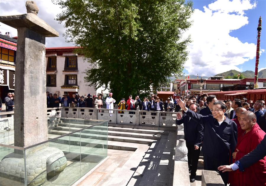 Chinese Premier Li Keqiang (2nd R, front),  greets tourists while visiting Jokhang Temple in Lhasa, Tibet on, July 26, 2018.  (Photo courtesy: Xinhua/Yin Bogu)