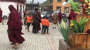 Young Tibetan monks are escorted from Dza Sershul monastery, July 10, 2018. (Photo courtesy: RFA)