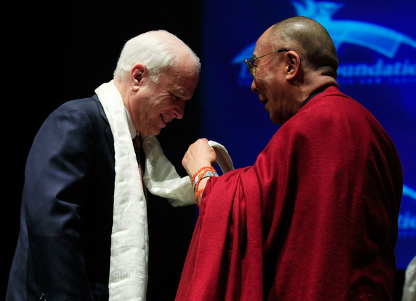The Dalai Lama (R) presents Sen. John McCain (R-AZ) (L) with a Khata during a ceremony at the U.S. Capitol on October 6, 2009 in Washington, DC. The Lantos Foundation for Human Rights and Justice hosted the ceremony to honor the Dalai Lama as the first recipient of the Lantos Human Rights Prize. (Photo courtesy: zimbio)