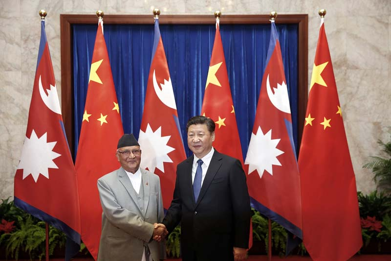 Chinese President Xi Jinping (right) shakes hands with Prime Minister Khadga Prasad Oli (left) inside the Great Hall of the People Monday, on March 21, 2016 in Beijing, China. (Photo courtesy: Lintao Zhang / AP)