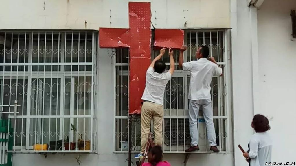 Police and authorities in Henan, China, raided a Christian church at the break of dawn on Sept 5. Church crosses were removed and Christian slogan on the walls were erased. (Photo courtesy: VOA)