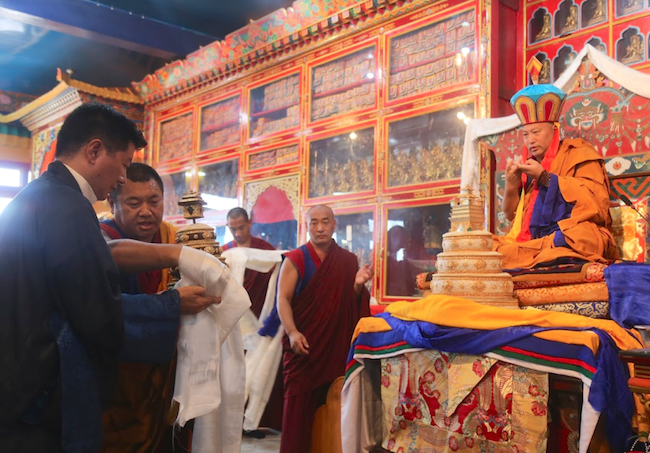 The 34th Kyabje Menri Trizin, the head of Tibet's pre-Buddhist religion Bonm was enthroned in a grand ceremony held at the Menri Monastery, located in Dolanji, Himachal Pradesh, India, over Sep 6-7. President Dr Lobsang Sangay, Central Tibetan Administration making a mandala offering. (Photo courtesy: TIBET.NET)