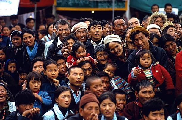 A crowd of Tibetan refugees in Dharamsala in the state of Himachal Pradesh waiting for the arrival of His Holiness the Dalai Lama on Losar (New Year's morning). (Photo courtesy: Himalayan pilgrimage book)