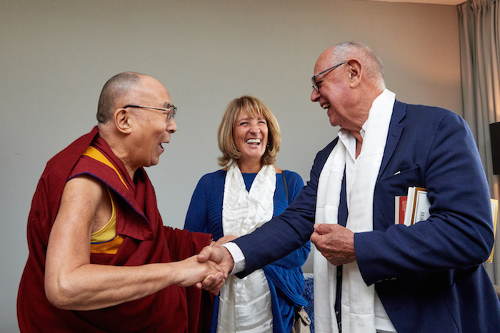His Holiness the Dalai Lama enjoying a light moment with Élisabeth Toutut-Picard and her husband during the audience held in September 2018. (Photo courtesy: Olivier Adams)