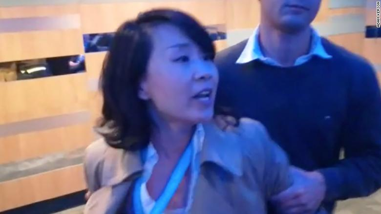 United Kingdom drops charges against Chinese reporter who had gone berserk at a Conservative Party conference fringe event