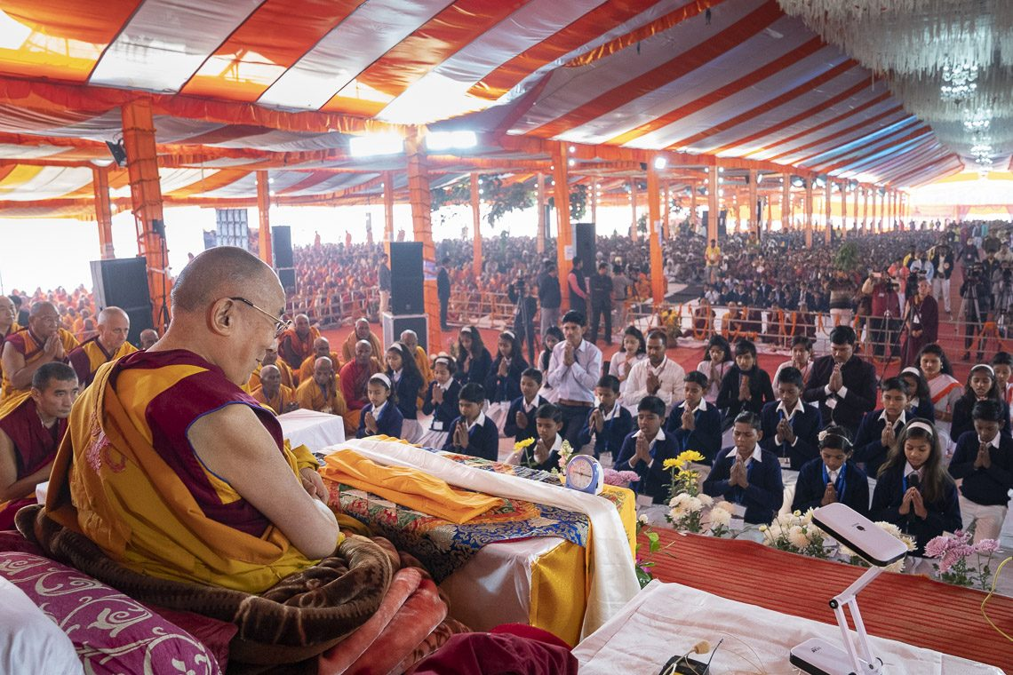 Local school children reciting prayers at the start of the second day of His Holiness the Dalai Lama's teaching at the Youth Buddhist Society of India Ground in Sankisa, UP, india on Dec 4, 2018. (Photo courtesy: OHHDL)