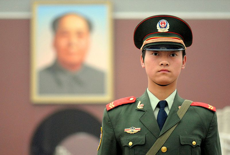 Top official warns China's police to watch out for 'color revolution'