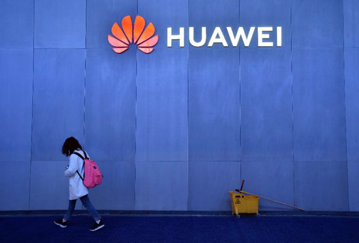 China's official media castigates Poland for arresting Huawei employee sacked by the tech giant itself for spying