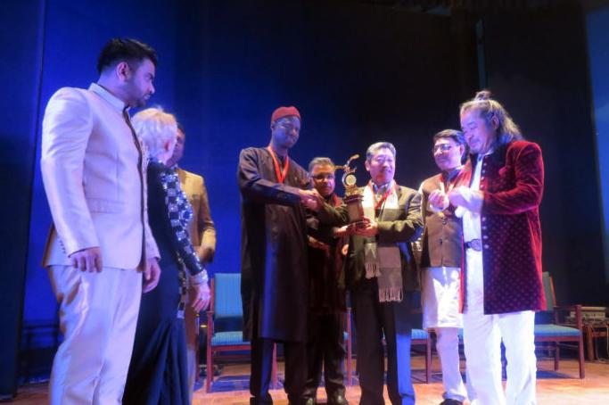 Global art group presents annual peace award to Tibetan people