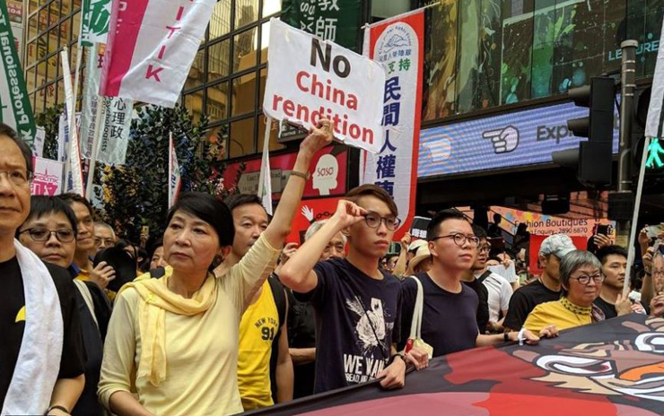Some 130,000 rally in Hong Kong to protest proposed extradition law amid China fears