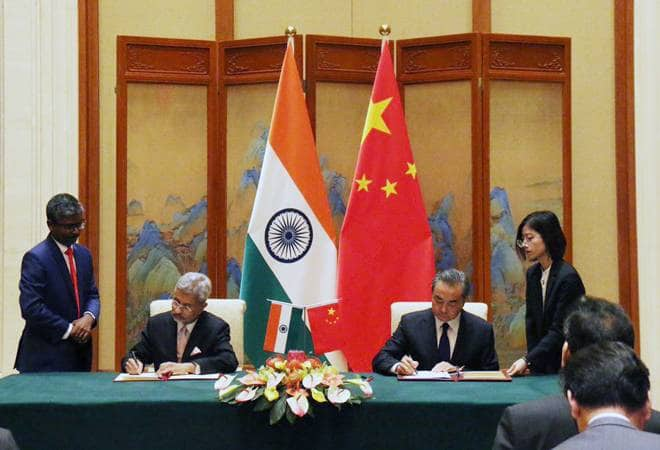 Agreeing that differences should not become disputes, India and China sign four MoUs, to organize 100 activities