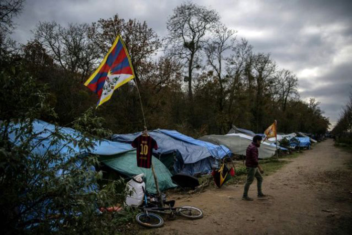 Some 600 Tibetan asylum seekers in France removed to shelters from forest camp in latest evacuation