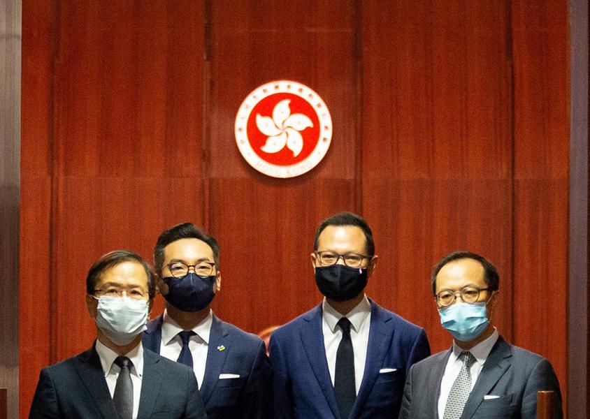 Hong Kong's pro-Beijing legislators celebrate the ouster of their pro-democracy peers