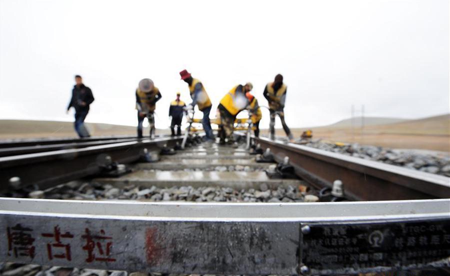 China lowers Covid-19 emergency alert in Tibet, helps migrant workers' return