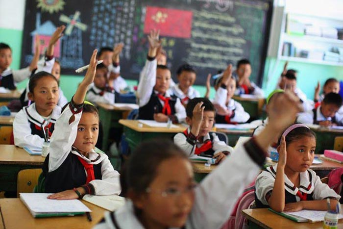 China criticized for criminalizing Tibetan advocacy of their native tongue, Sinicizing education