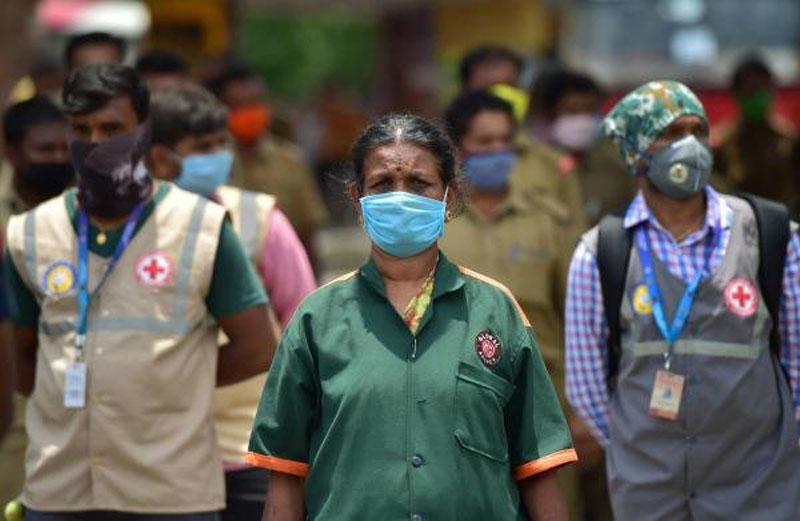 India reports record single-day spike in Covid-19 cases week before lifting lockdown