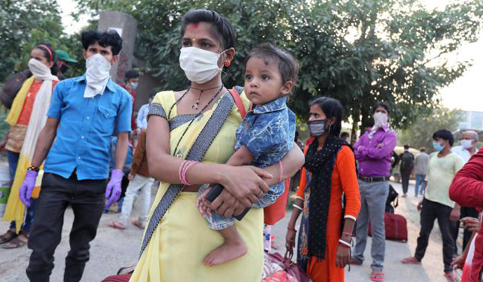 India hits record new Covid-19 cases with more testing