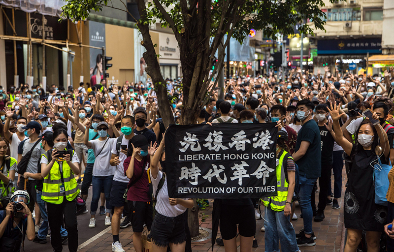 Hundreds protest as draconian China national security law for Hong Kong comes into force